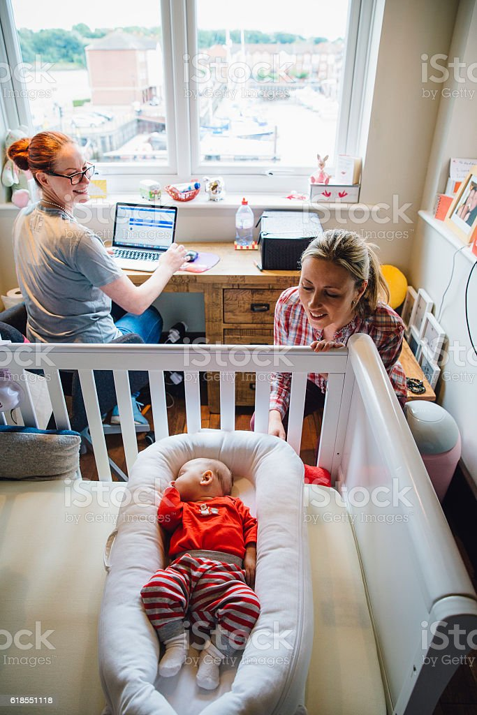 Checking on the Baby stock photo
