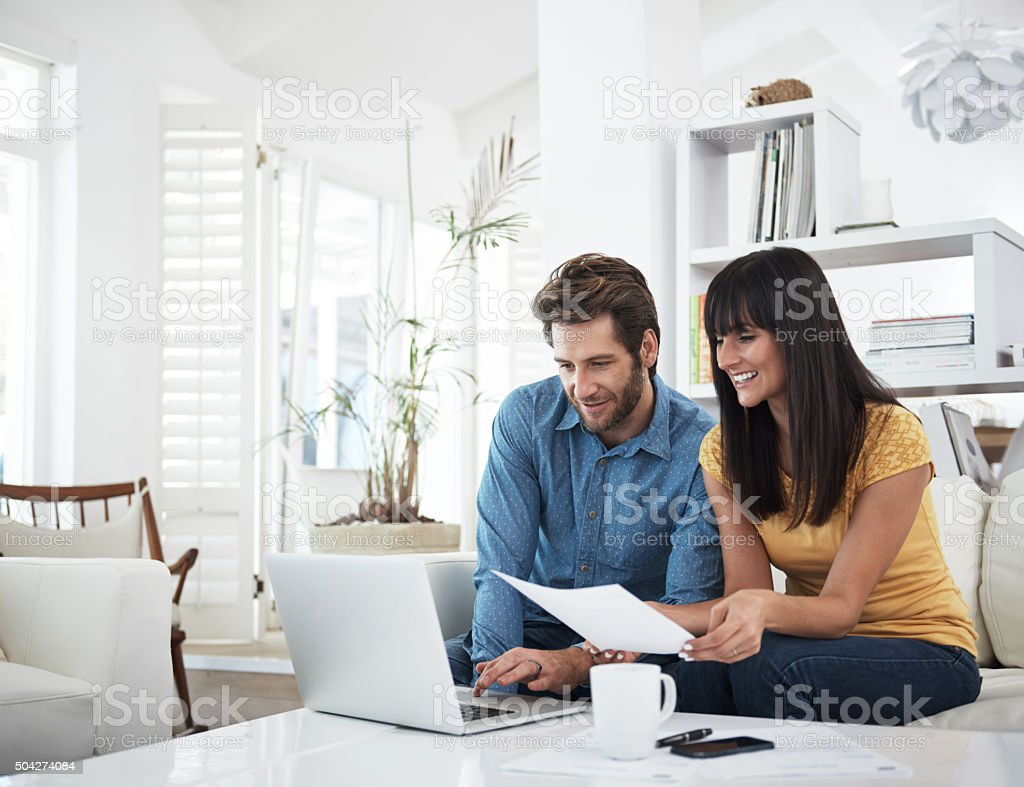 Checking on their investments stock photo