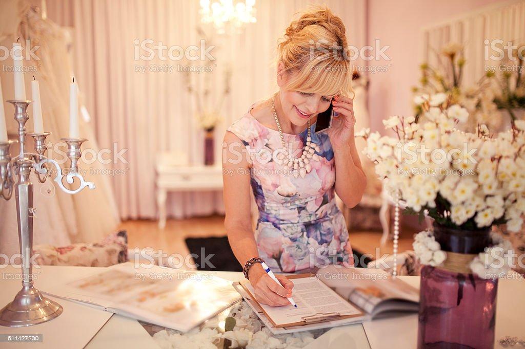 Checking order at bridal shop stock photo