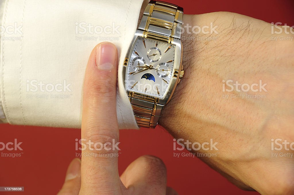 Checking out the time royalty-free stock photo