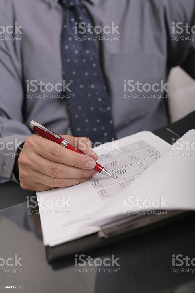 checking papers royalty-free stock photo