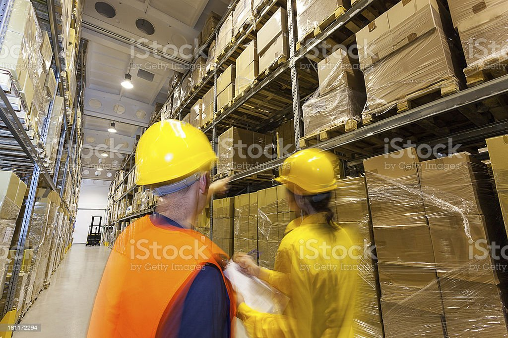 Checking products in warehouse royalty-free stock photo