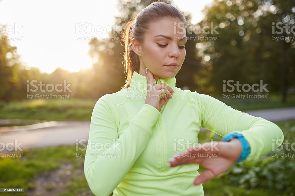 Checking pulse before jogging stock photo