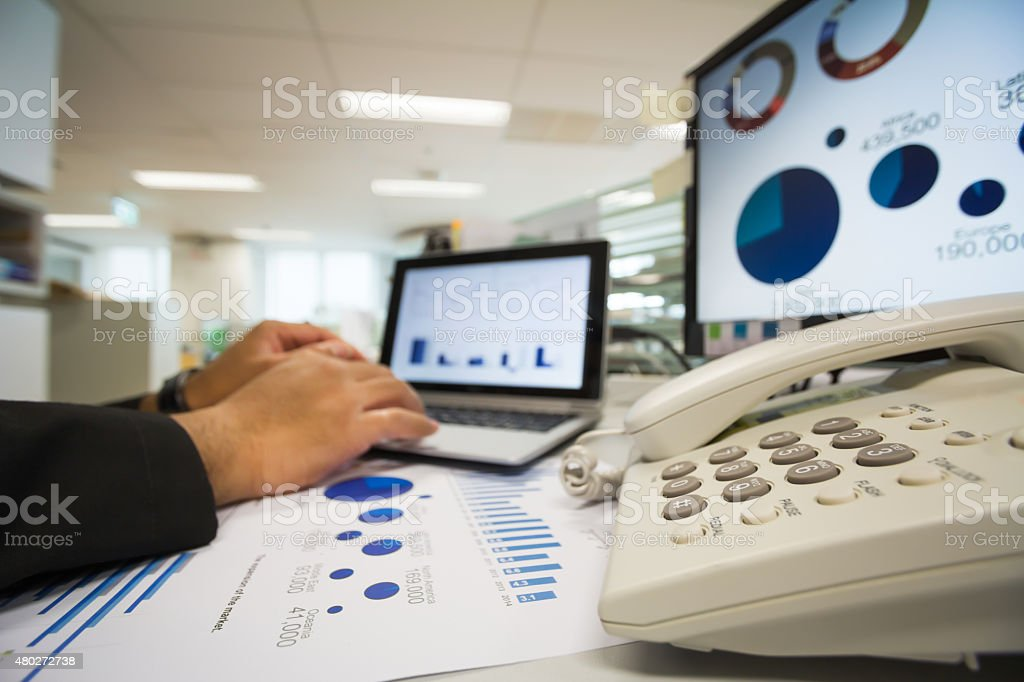 Checking reported profits. stock photo