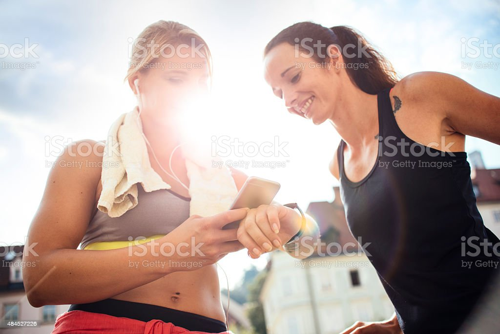 Checking results on smart phone stock photo