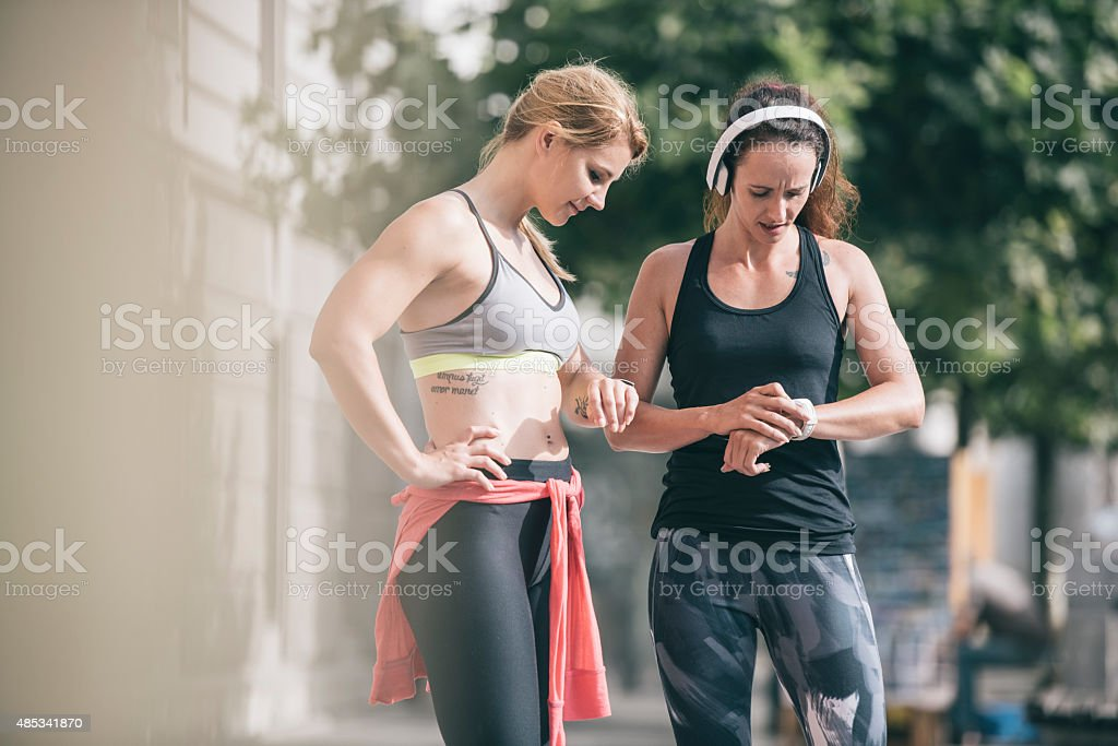 Checking results on smart watch stock photo