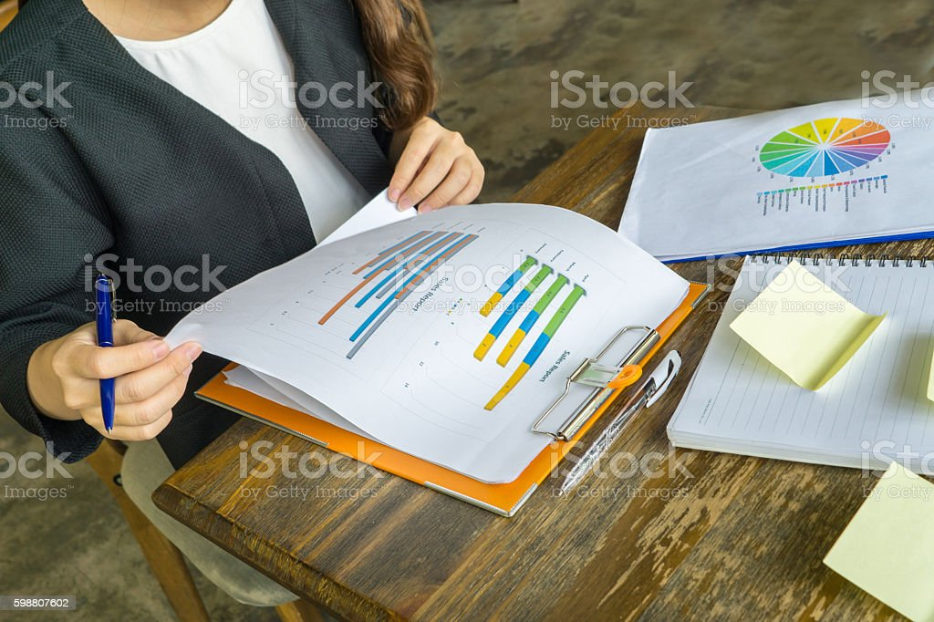 Checking sales reports is important role of sales manager stock photo
