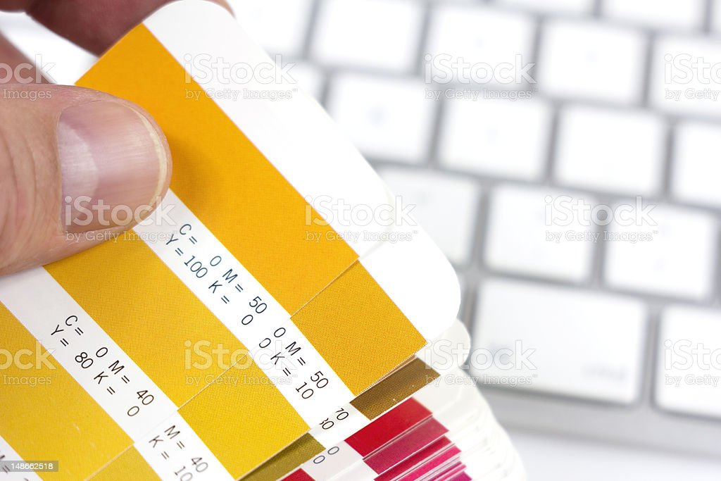 Checking shades of color using color cards stock photo