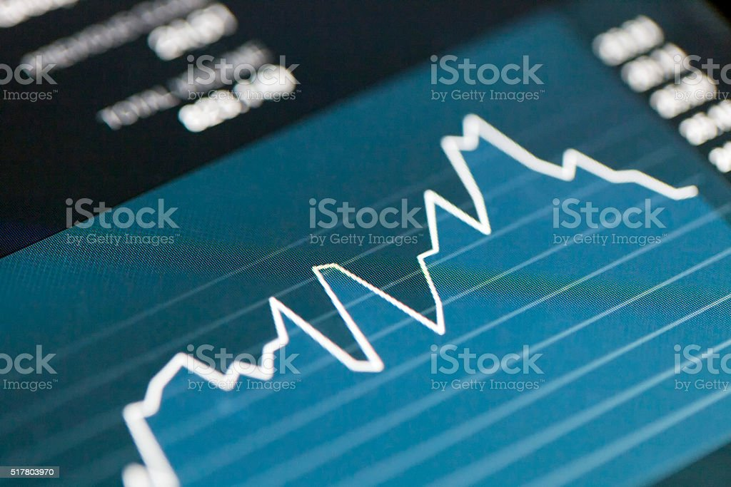Checking Stock Market Flow on a Digital Tablet stock photo