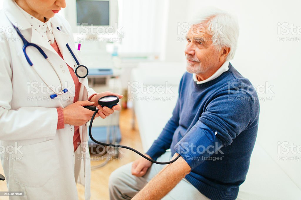 Checking the blood pressure stock photo