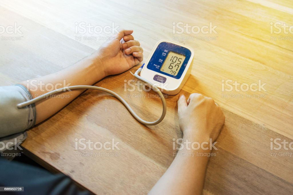 checking the blood pressure with a modern digital equipment stock photo