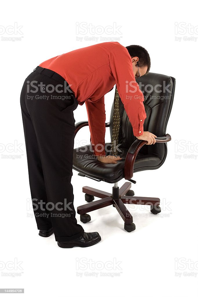 Checking the chair royalty-free stock photo