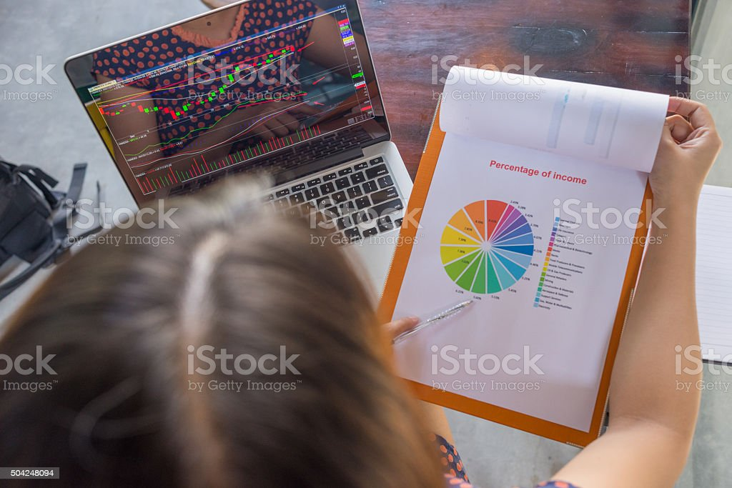Checking the change of stock market with company's income report stock photo