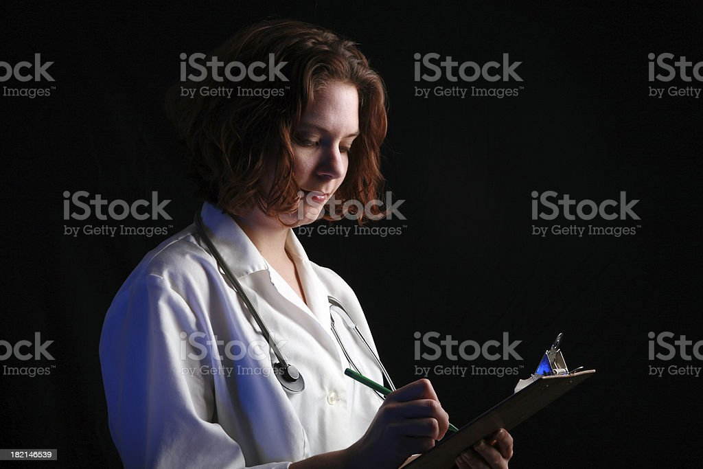 Checking The Chart royalty-free stock photo