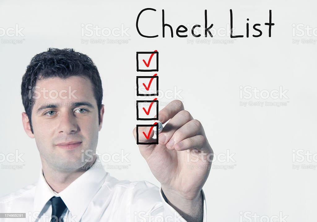Checking the checklist royalty-free stock photo