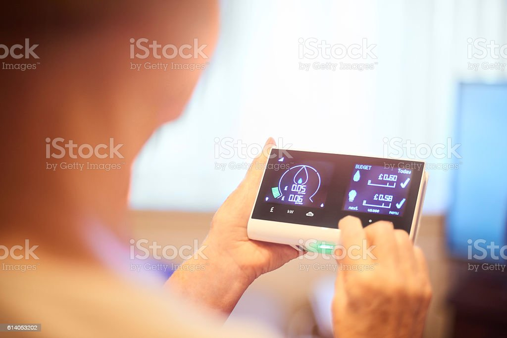 Checking the days energy consumption stock photo