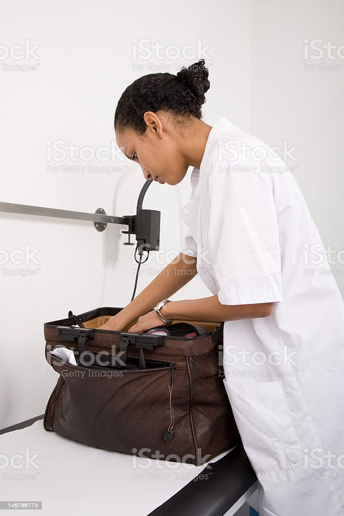 Checking the doctors bag stock photo