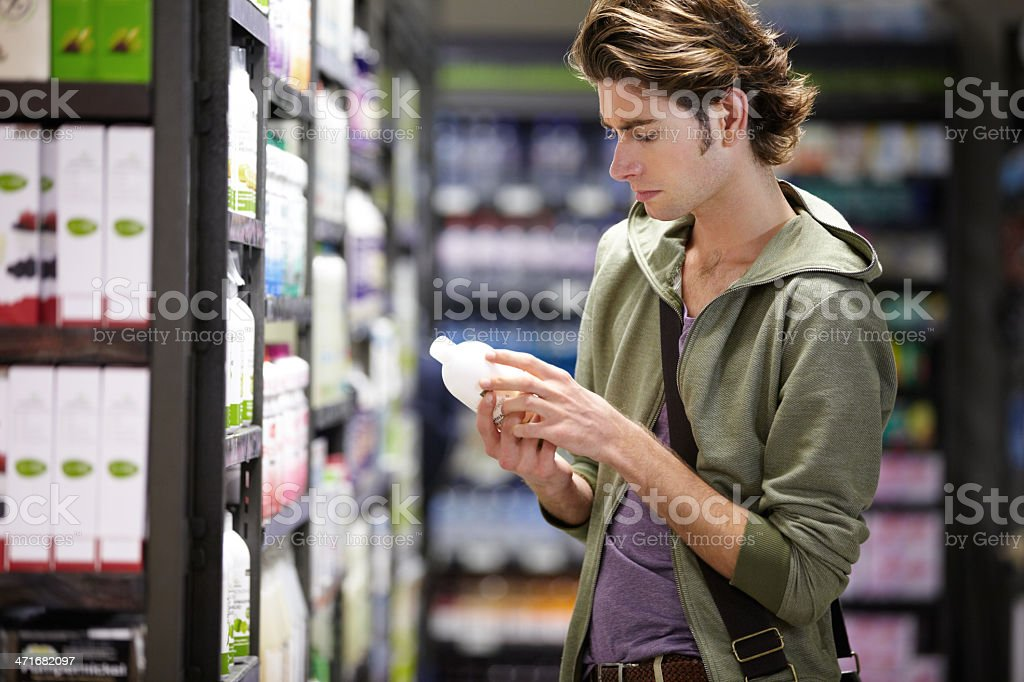 Checking the expiry date stock photo