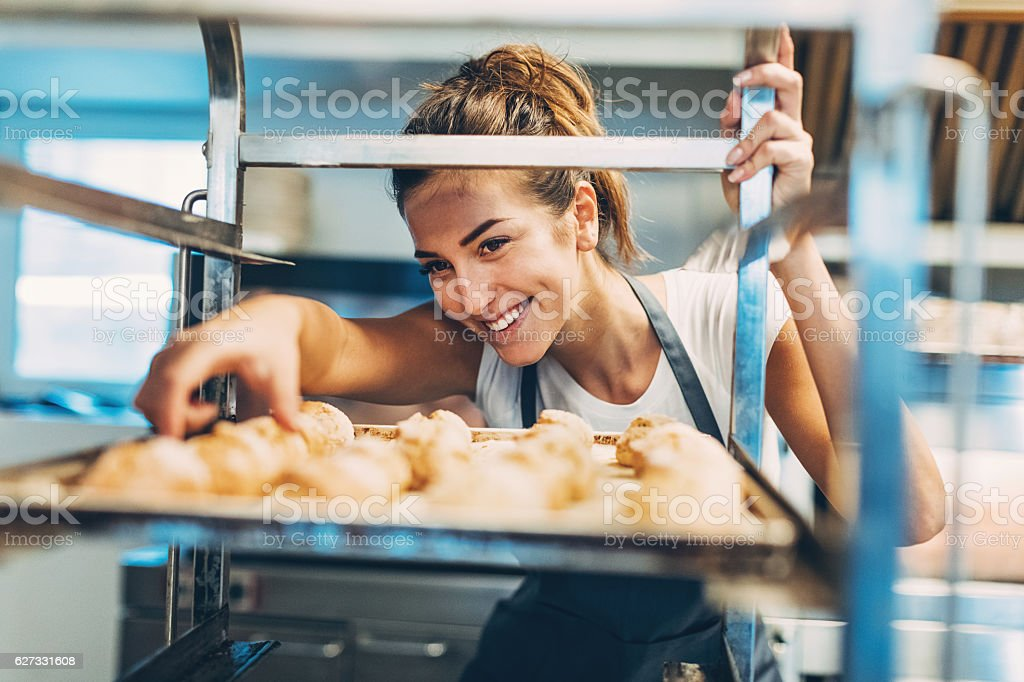 Checking the freshly baked croissants stock photo