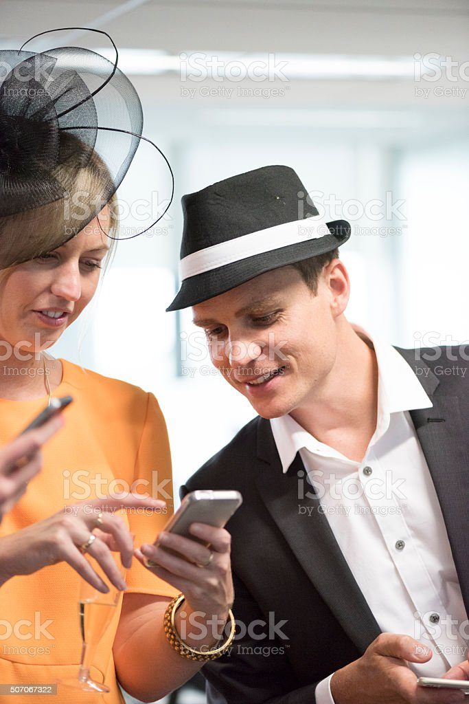 Checking The Horse Racing Results stock photo