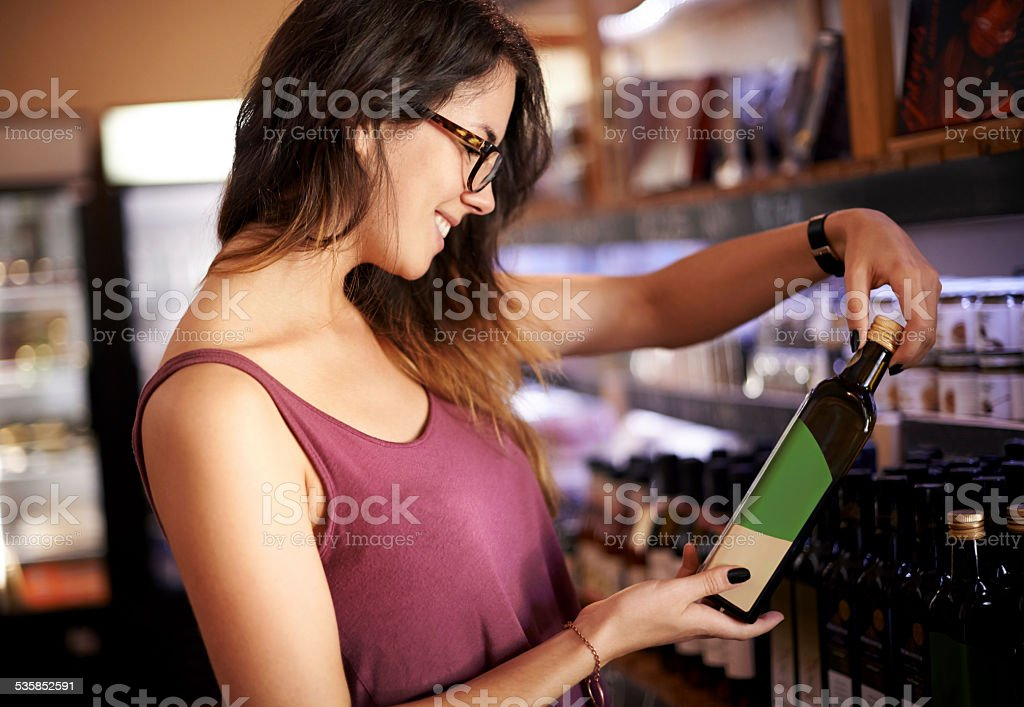 Checking the ingredients label stock photo