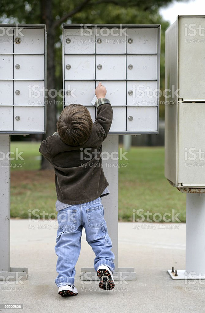 Checking the mail on a cool day stock photo