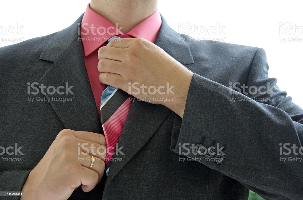 Checking the necktie stock photo