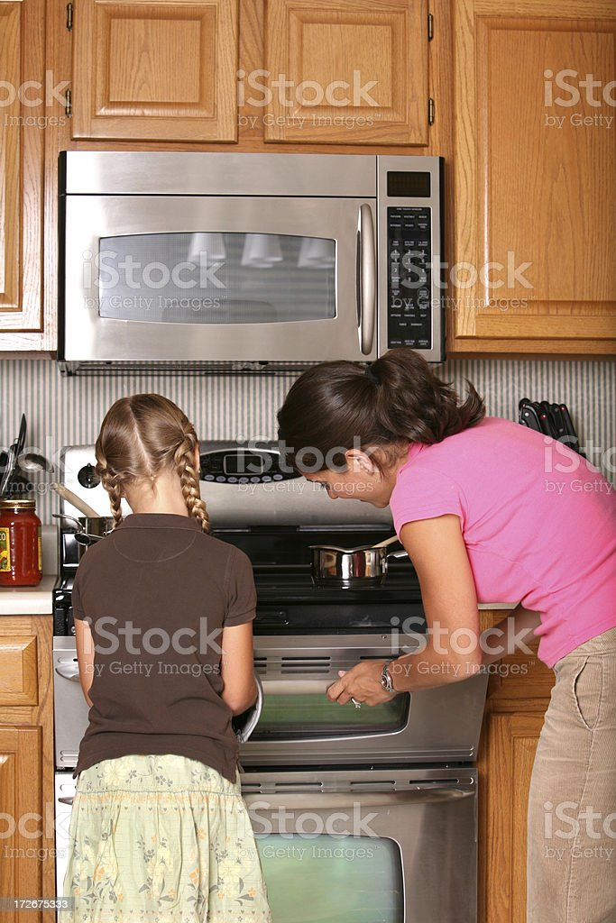 Checking the Oven stock photo
