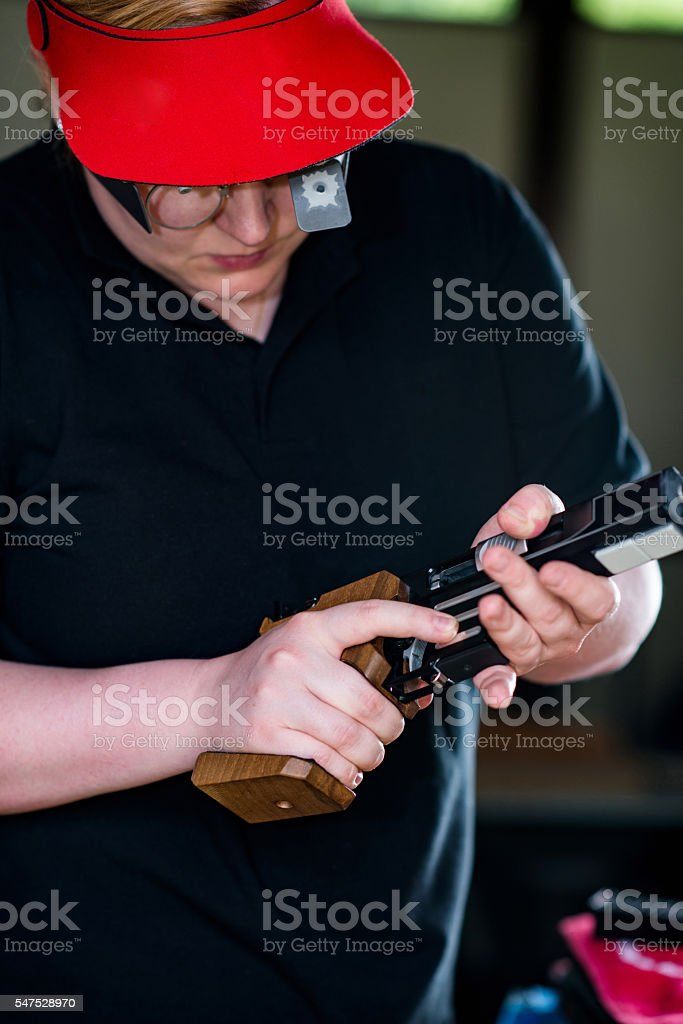 Checking the pistol at the shooting range stock photo