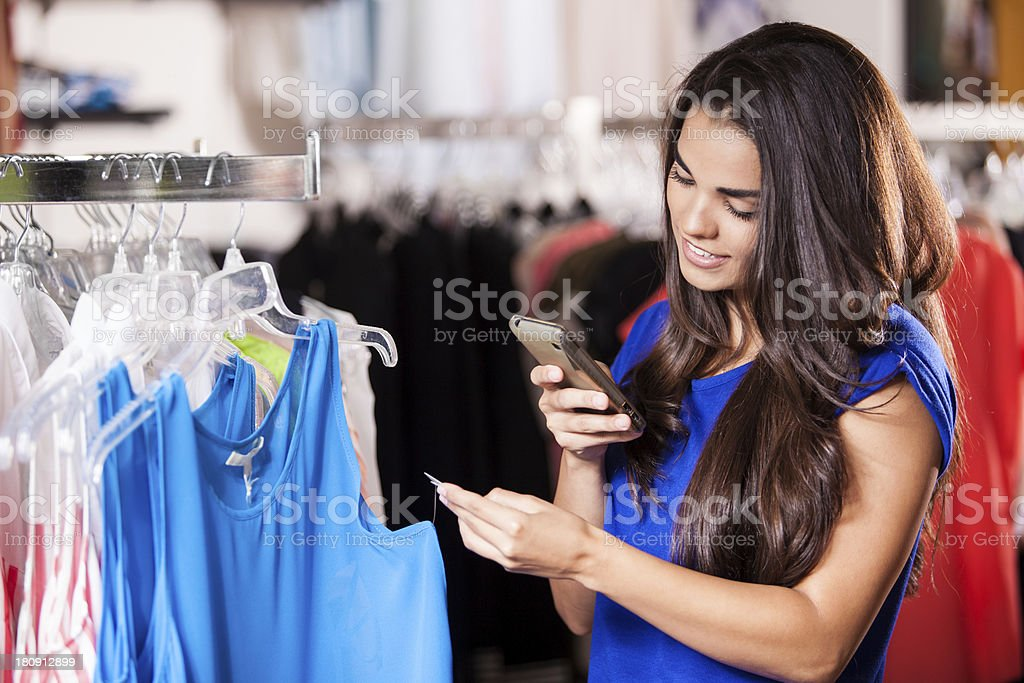 Checking the price tag of a blouse royalty-free stock photo