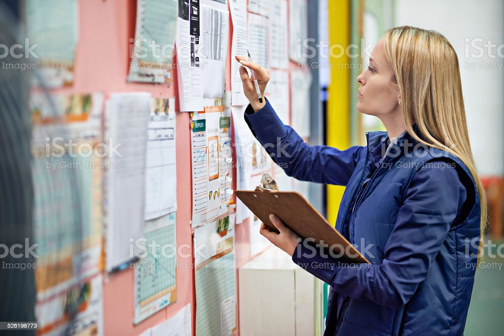 Checking the shipping calender stock photo