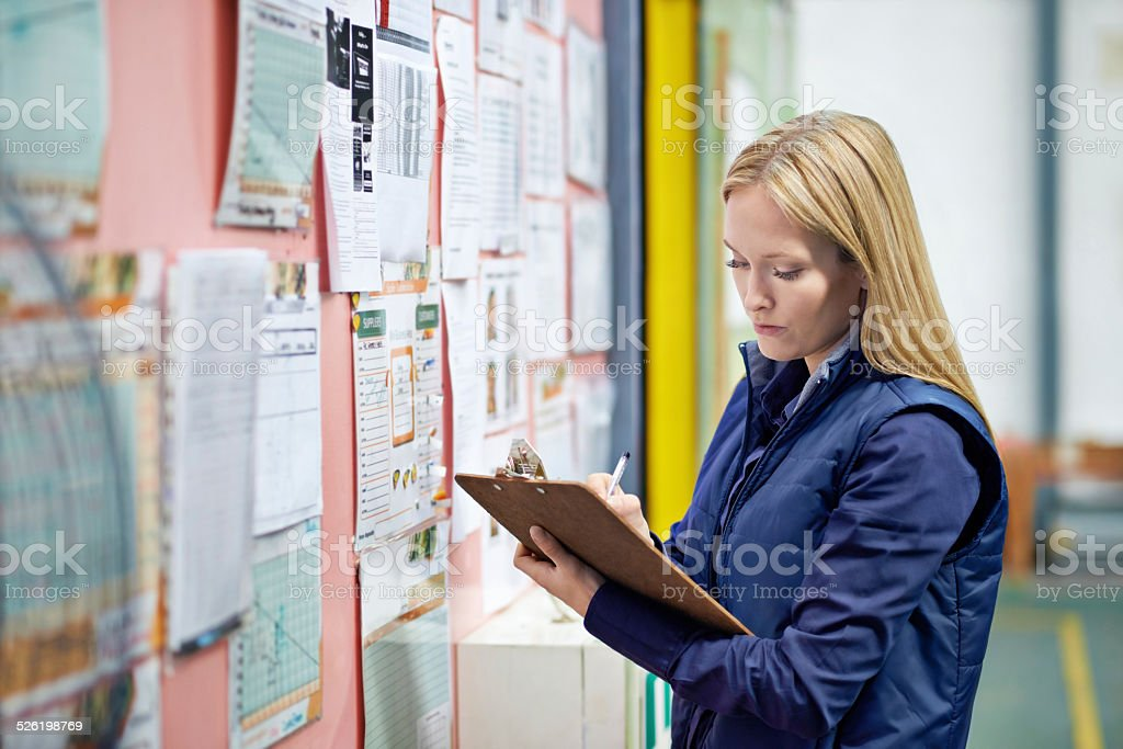 Checking the shipping schedule stock photo