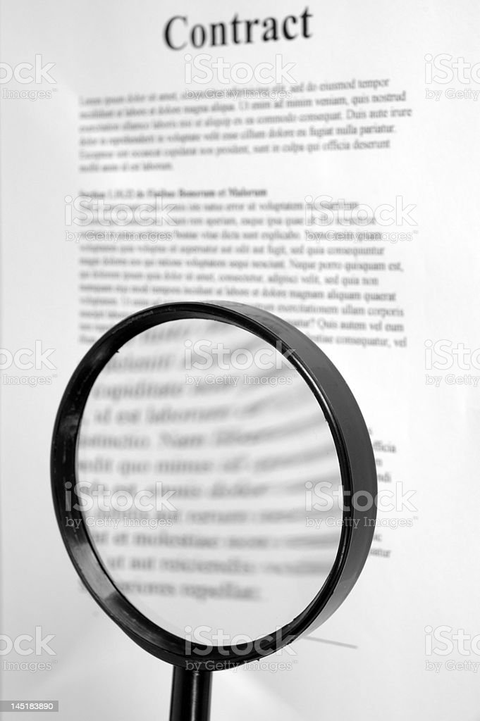 Checking the small print. stock photo