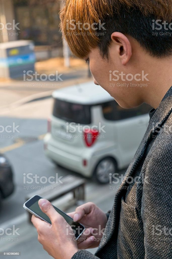 checking the smartphone stock photo