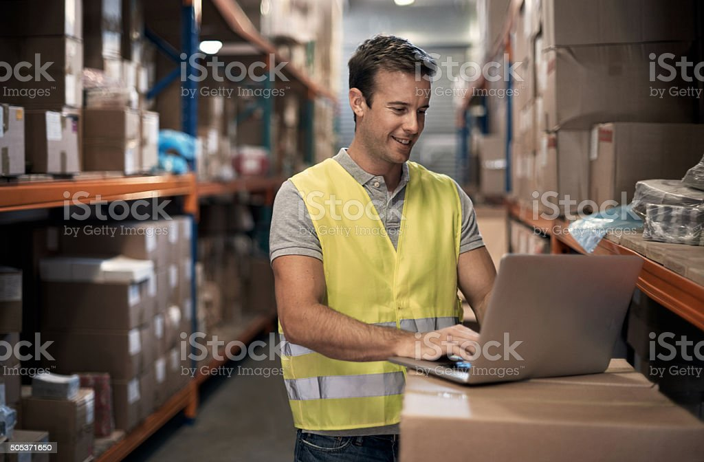 Checking the status of an incoming shipment stock photo