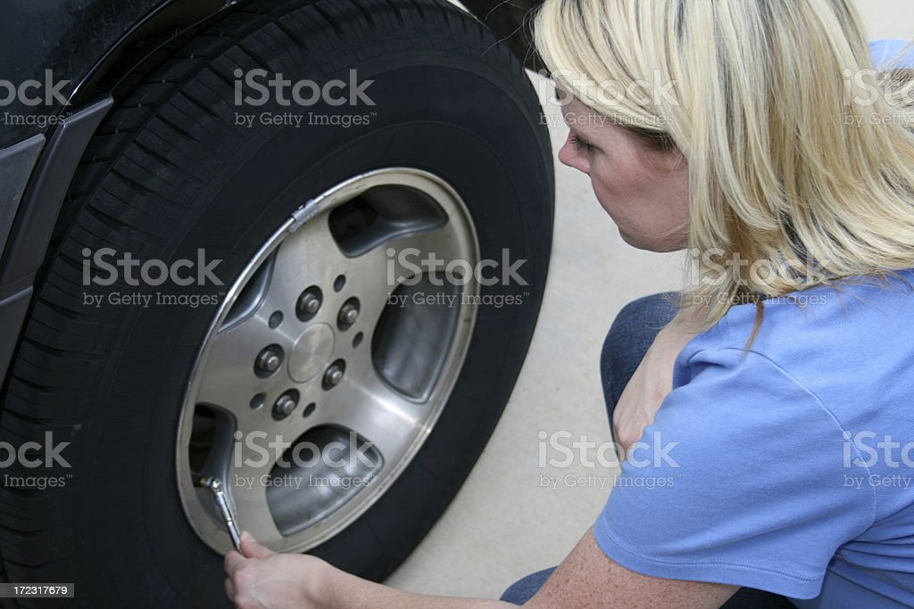 Checking the Tire royalty-free stock photo