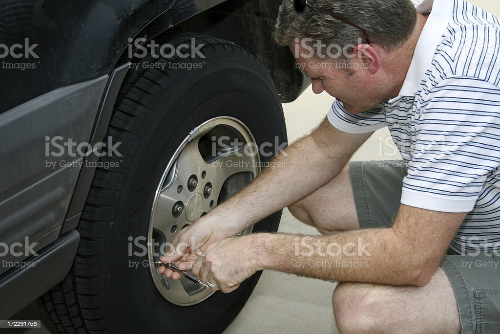 Checking the Tires royalty-free stock photo