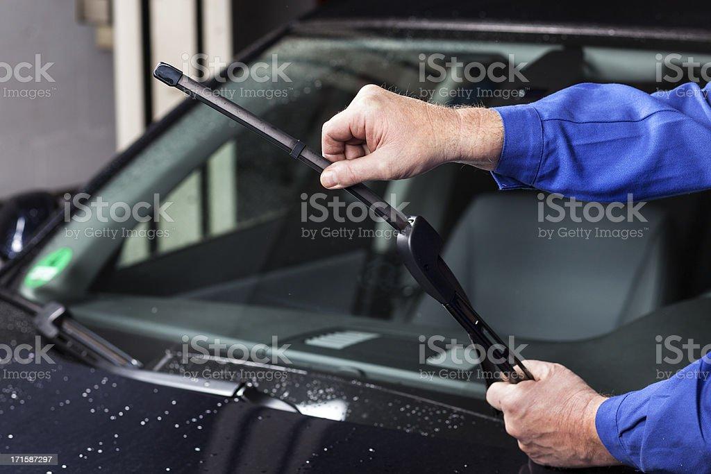 Checking the windscreen wiper stock photo