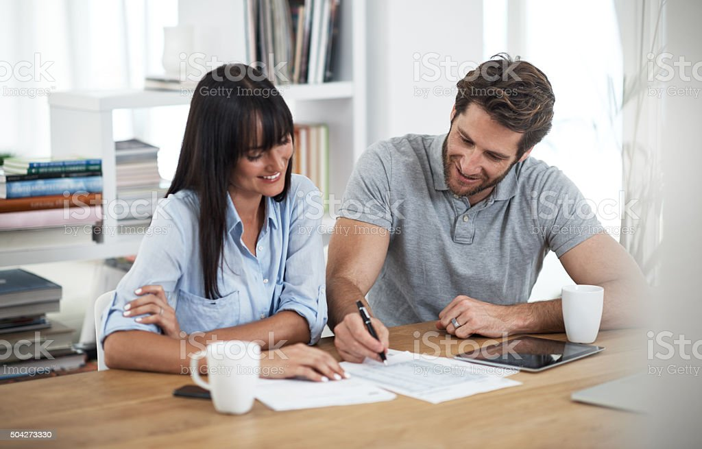 Checking their investment account stock photo