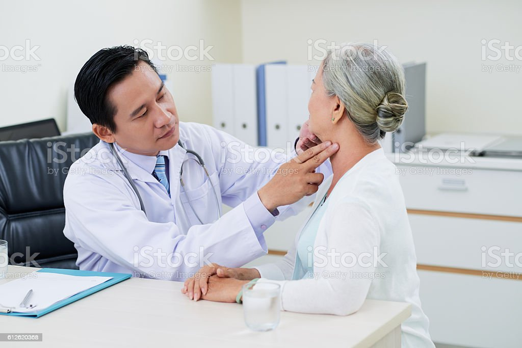 Checking thyroid glands stock photo