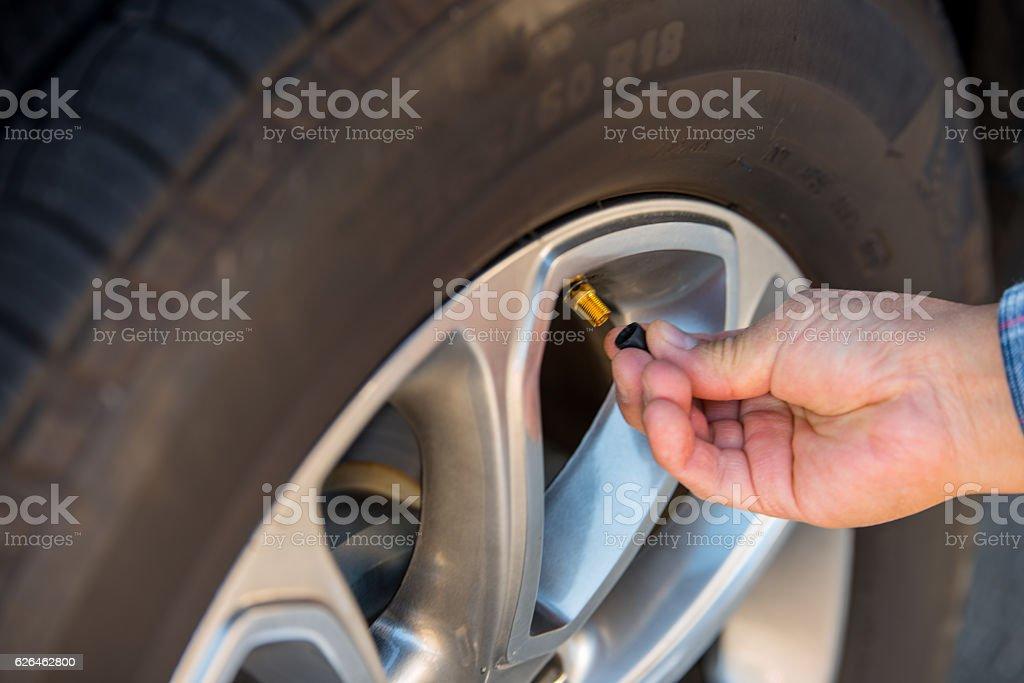 Checking Tire Valve Stem stock photo