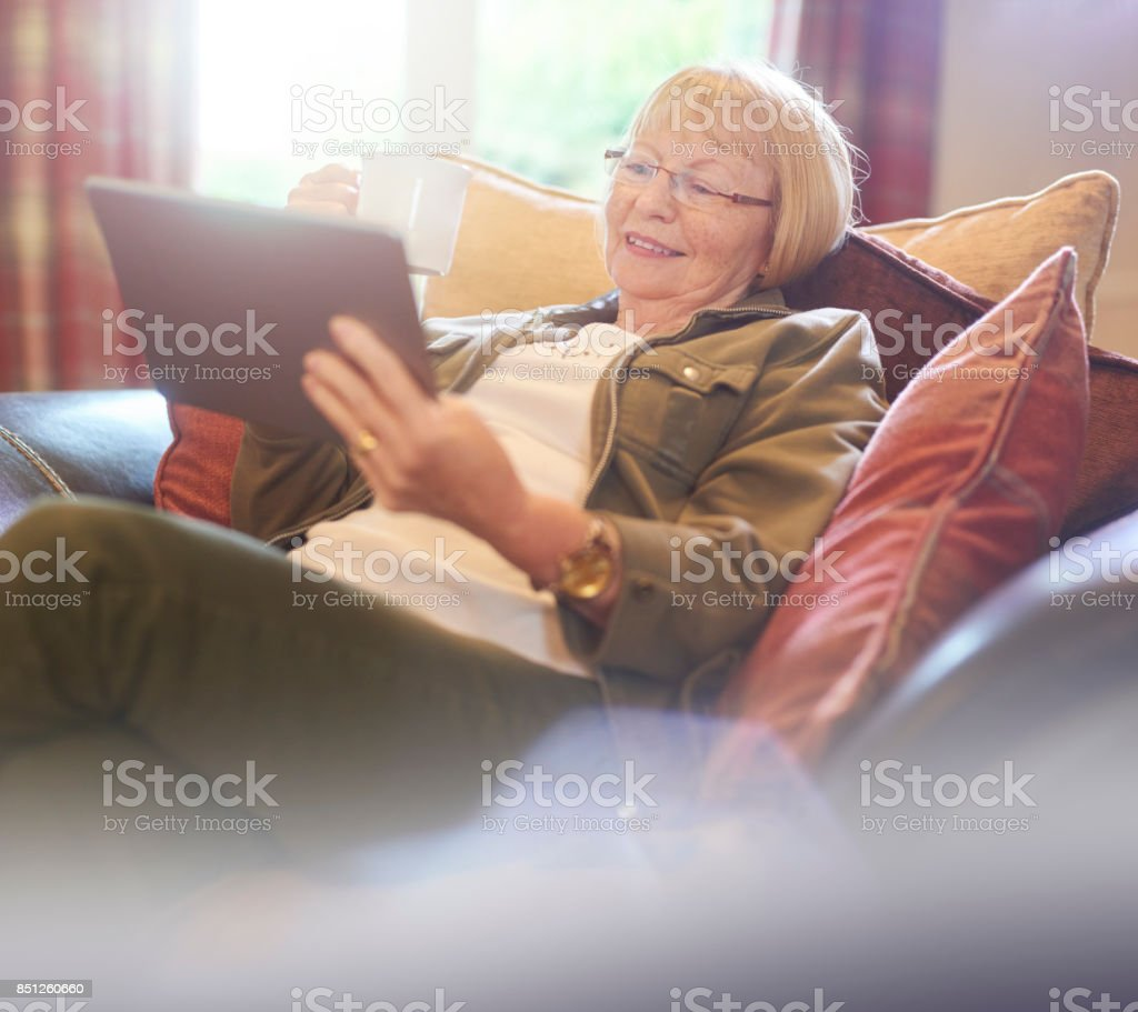 checking up on the days news stock photo