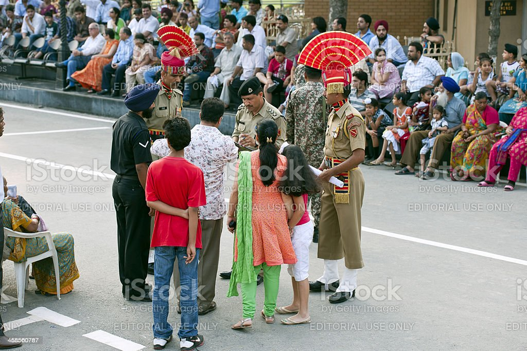 Checking VIP List for Flag Ceremony Border stock photo