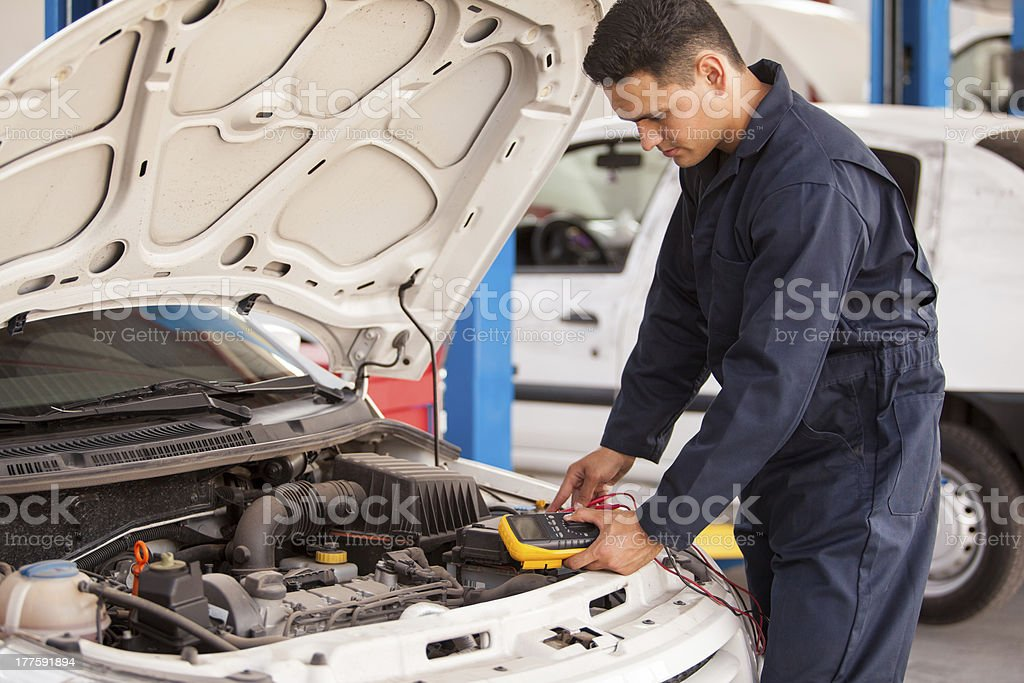 Checking voltage of a battery royalty-free stock photo