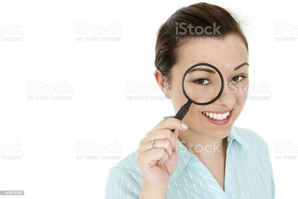 Checking Your Facts - Attractive Business Woman with magnifying glass royalty-free stock photo
