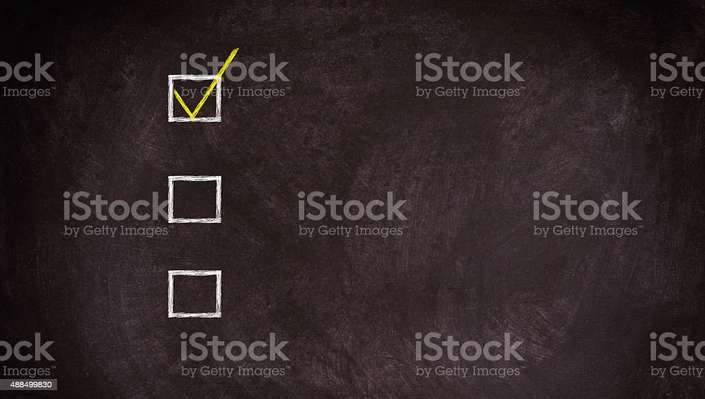 Checklist at the blackboard with copy space stock photo