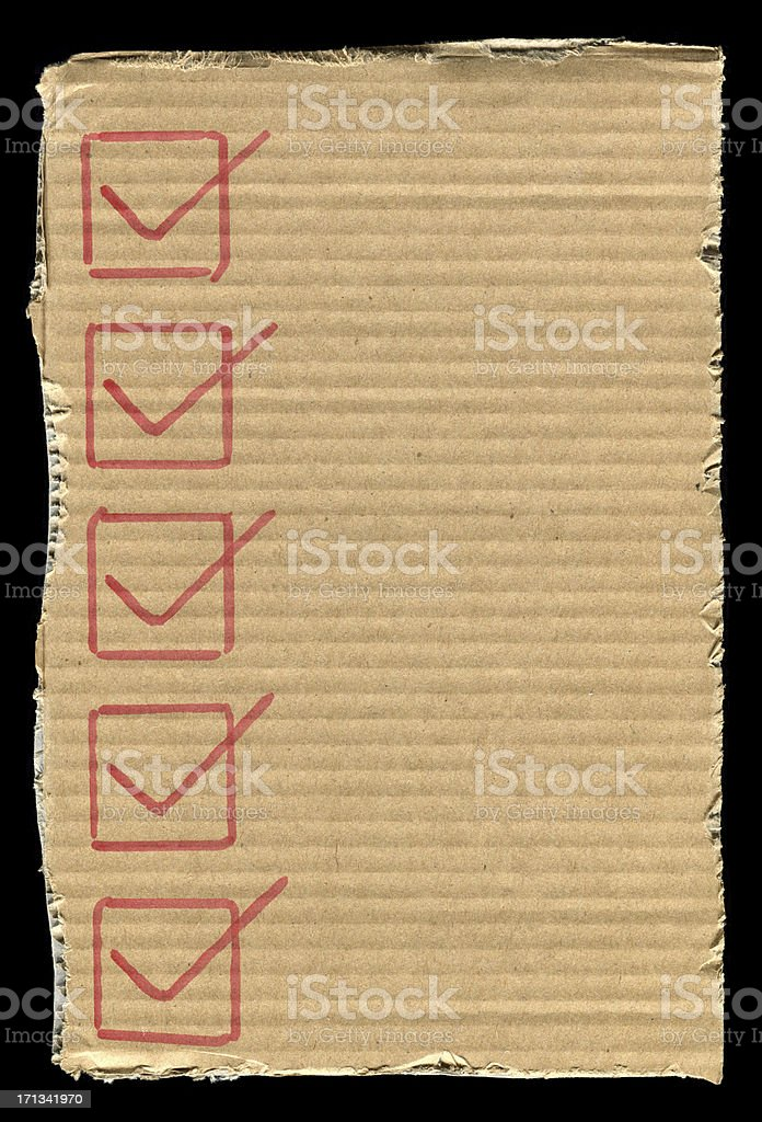 Checklist in the cardboard paper textured background royalty-free stock photo