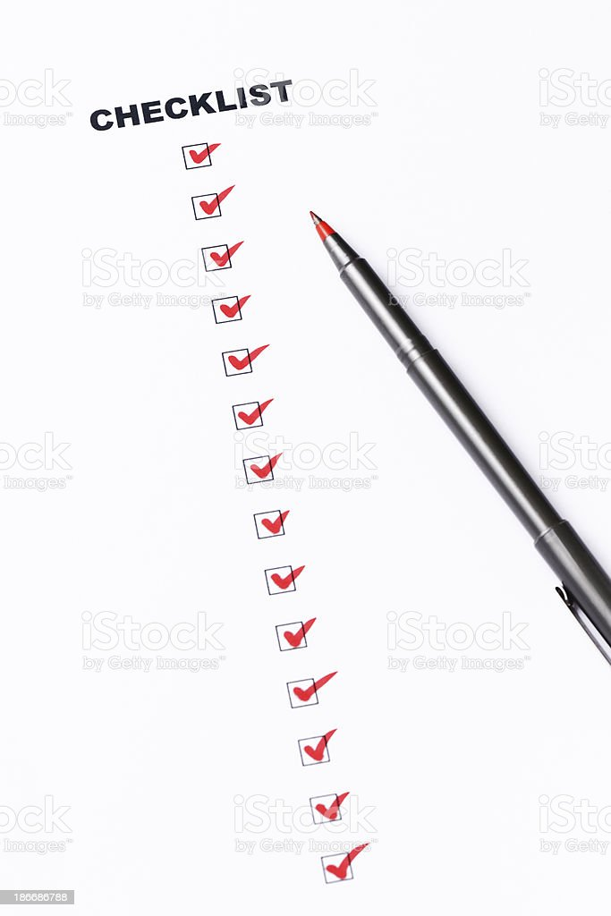 Checklist of completed work with red check mark and pen royalty-free stock photo
