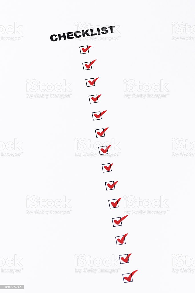 Checklist of completed work with red check mark royalty-free stock photo