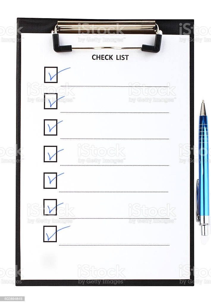 Checklist with blue pen stock photo